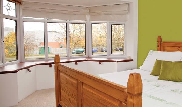 Sunny bay windows in bedroom